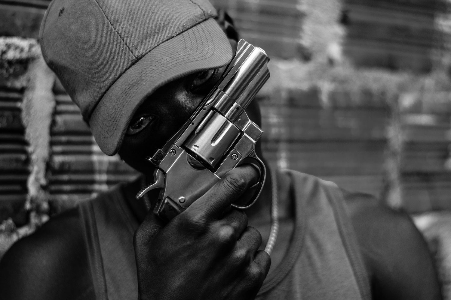 Jeison, a member of the gang 'La 33', poses with his revolver 38', which he uses to commit thefts or participate in gang clashes.