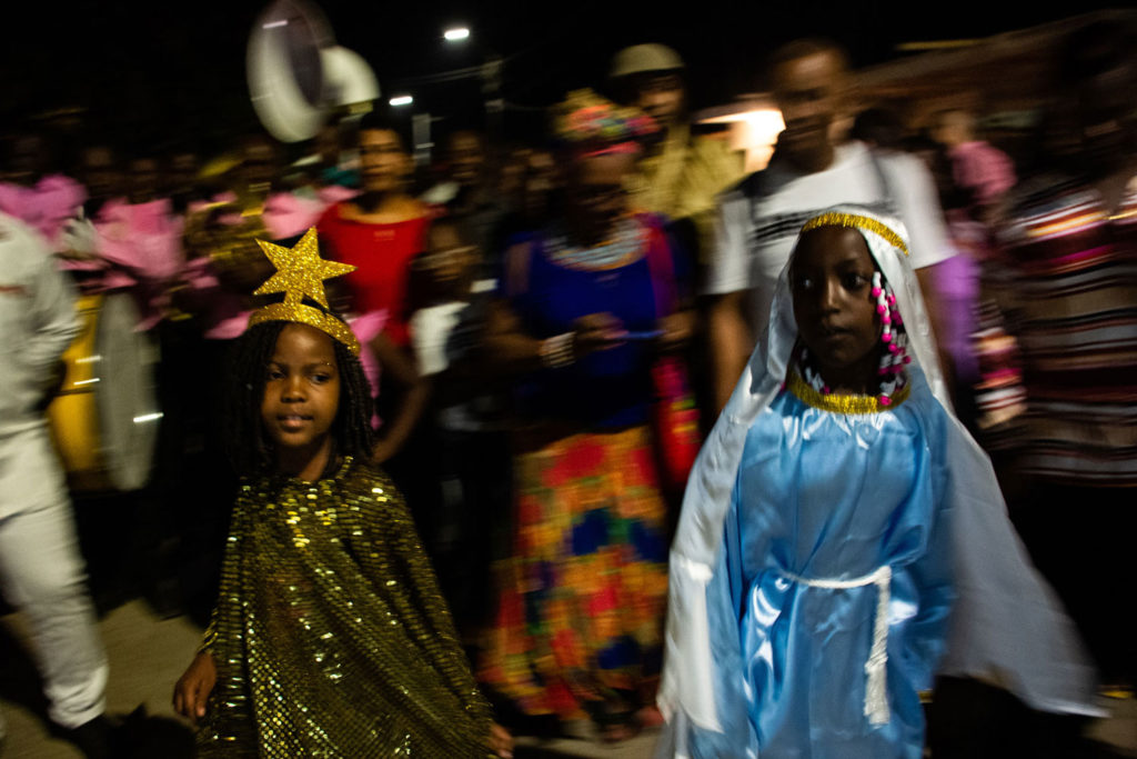 Two children disguised as Virgin Mary and The Star of Bethlehem dance in the middle of a procession.