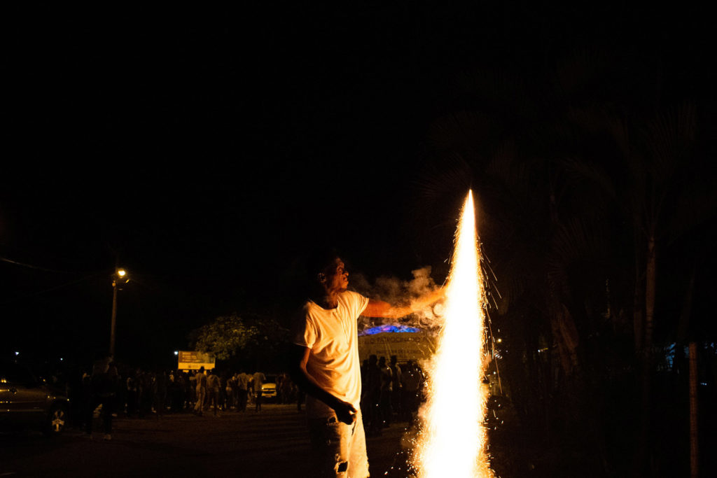A man from Quinamayó detonates a 'volador'. Firework plays an important function in the parties.
