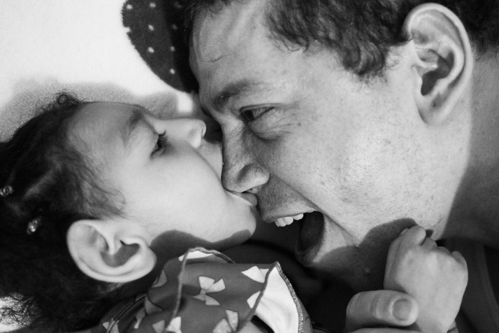 Jean Paul Velázquez, 42, plays with his daughter Samara in her room.