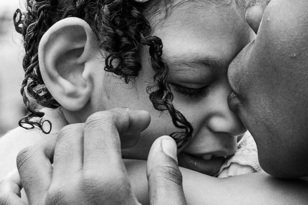Samuel Felipe López, 12, kiss her cousin Samara during her third birthday. October 20, 2019.