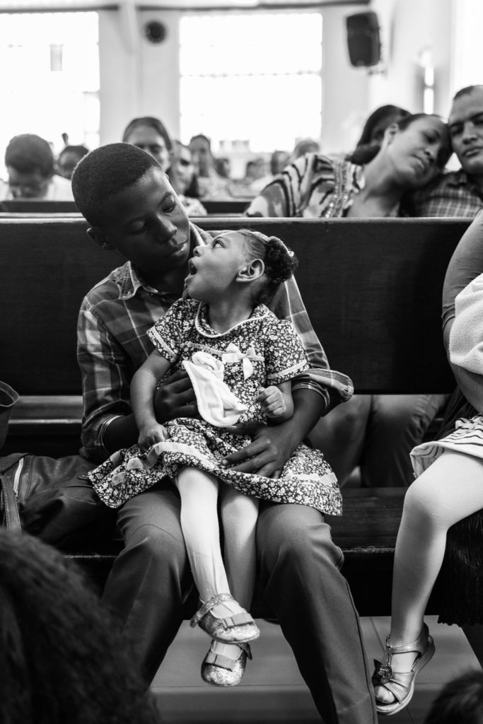 Samuel holds Samara during a mass at the Adventist Church in the La Independencia neighborhood, south of Cali. All Eliana's family are adventist for tradition. April 27, 2019.