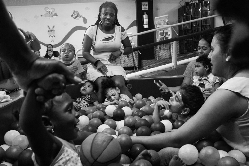 Eliana and her daughter, Samara, participate in a Christmas celebration for children with microcephaly in a restaurant of Cali. After the Zika epidemic, many mothers formed groups in different cities of Colombia to support each other, especially to solve the difficulties to access health services and face the injustices of medical insurances. December 21, 2019.