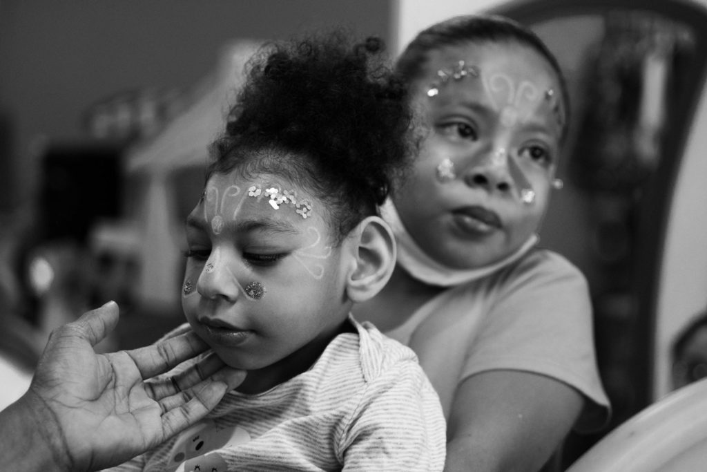 During the Christmas celebration for children with microcephaly in a restaurant of Cali, Brianna, 8, holds her sister, Samara. Sometimes Brianna feels that she is relegated from her mother love, because Eliana must be more aware upon Samara, due to her condition. December 21, 2019.