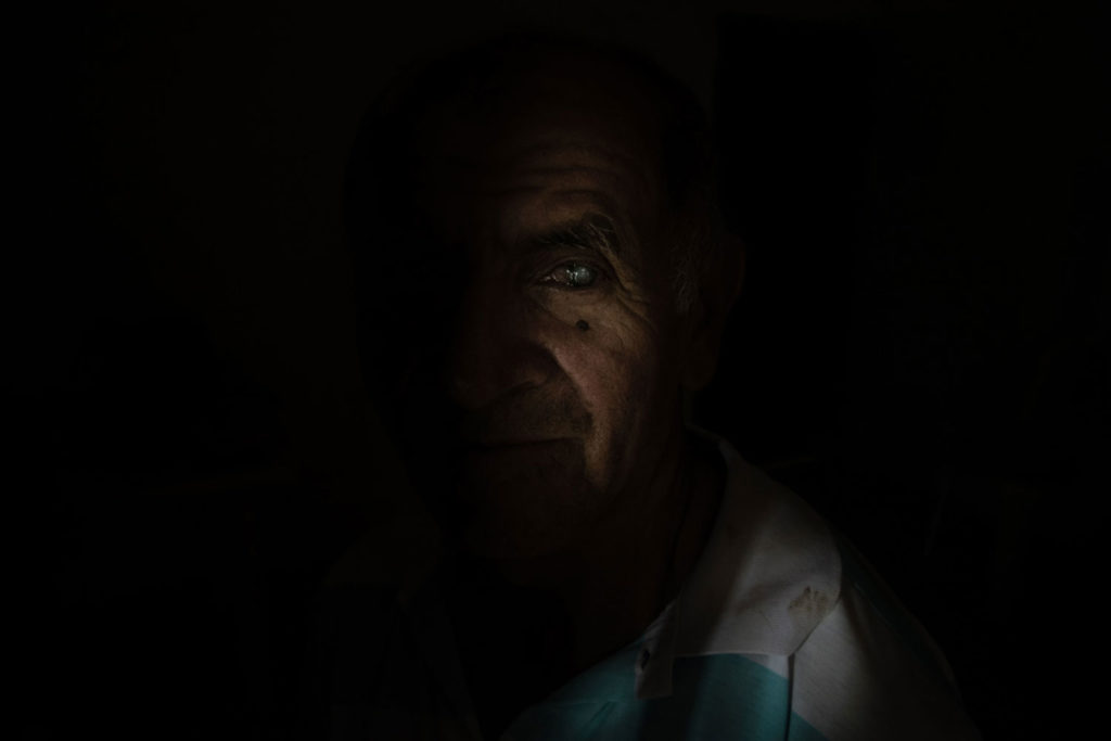 Pablo Campos, 64, whose left eye has cataracts, is former guerrillero of the FARC's mobile column Teófilo Forero, considered one of the most feared structures of that extinct armed group. Toro, Valle del Cauca department / April 22, 2018.