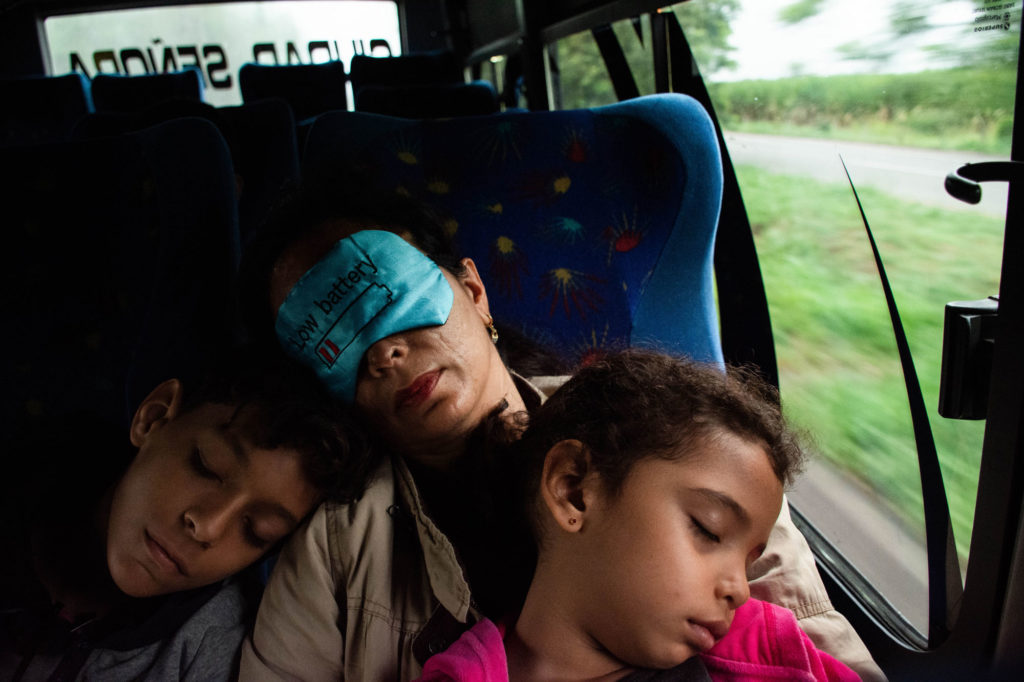 Andrés and Valentina, Diana's niece, sleep in her lap on a bus intermunicipal destined for Buga, municipality where the founder of Carita de Papel is originally from and where she was attacked with acid.